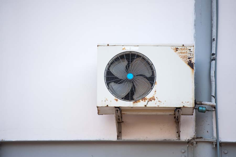 Air Conditioning Equipment outside of an old house. 3 Telltale Signs It's Time for a New AC.