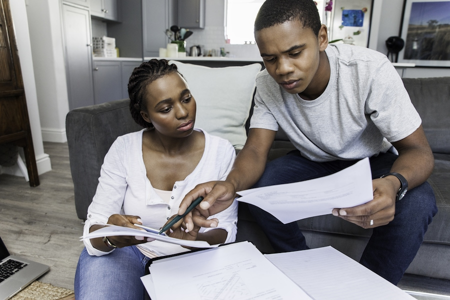 Beautiful couple working on their finances together.